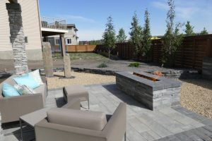Modern great interlocking patio with rectangular fire pit and flame burning